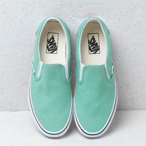 Mint green slip on vans